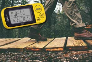 Picture of pedometer overlayed on picture of the lower legs of a hiker on a forest trail.