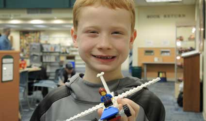 picture of boy with LEGO® bricks plane